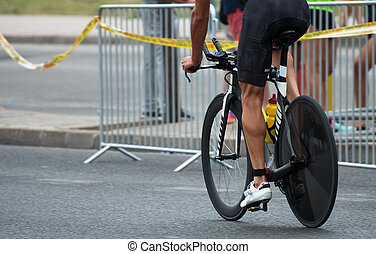 Unrecognizable professional cyclist during the bicycle competition.