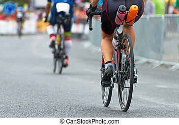 Unrecognizable professional cyclists during the bicycle competition. Back view.