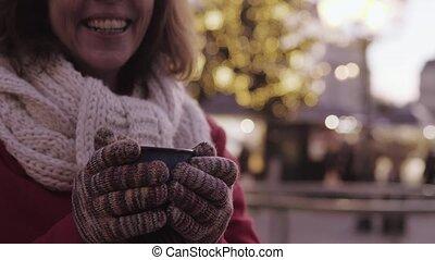 Unrecognizable senior woman on an outdoor Christmas market.