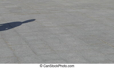Unrecognizable Skater doing trick fs 180 on flat, close-up view in slowmotion