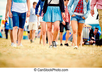 Unrecognizable teenagers, tent music festival, sunny summer...