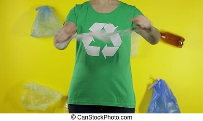 Unrecognizable woman free up from cellophane package. Save ecology. Plastic nature pollution