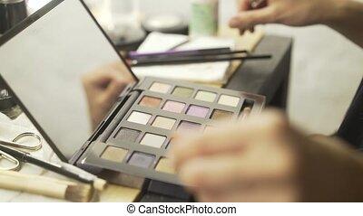 Unrecognizable woman getting ready to use a makeup kit