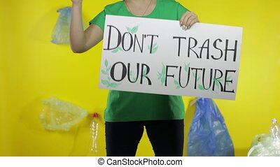 Unrecognizable woman holding protesting poster Don't Trash Our Future. Environment plastic pollution