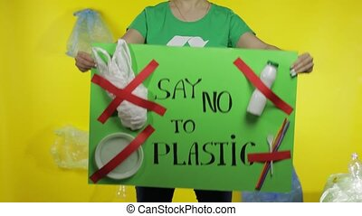 Unrecognizable woman holding protesting poster Say No To Plastic. Environment plastic pollution