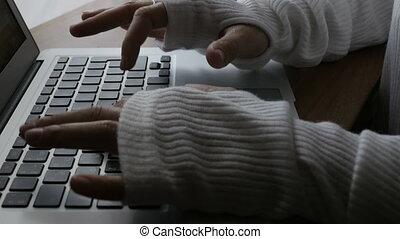 Unrecognizable woman typing laptop