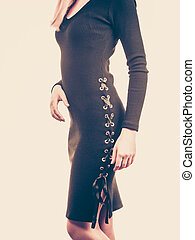 Unrecognizable woman wearing black dress