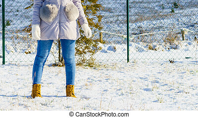 Unrecognizable woman wearing winter outfit