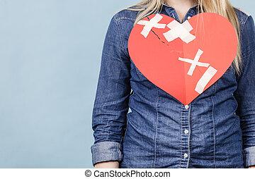 Unrecognizable woman with broken heart