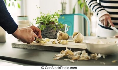 Unrecognizable women cooking at home. Close up of hands...