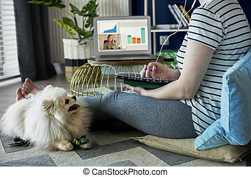 Unrecognizable young woman at home office
