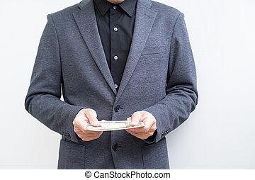 Unrecognize businessman with ten thousand Yen banknote