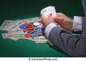 gambler playing cards in the casino