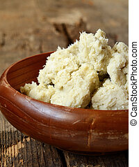 Unrefined shea butter - Unrefined raw shea butter on wooden...