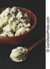 Unrefined shea butter - Unrefined raw shea butter on wooden...