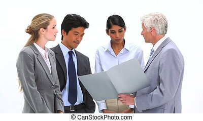Unsatisfied boss speaking to employees