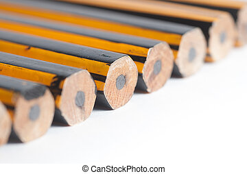 Unsharpened Pencils Lined up on a white background