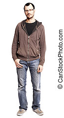 An adult caucasian man at his early 30's wearing casual sneakers, a pair of blue jeans and a hoodie over a black t-shirt. He's looking at the camera with a serious and somewhat tiresome gaze. Isolated on white background.