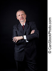 Unshaven businessman with crossed arms