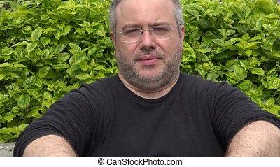 Unshaven Fat Adult Male Wearing Prescription Glasses