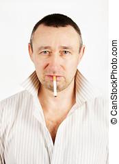 Unshaven man with a cigarette