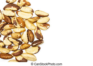 Lot of whole unshelled brazil nut copyspace on right flatlay isolated on white background