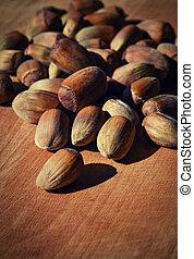 unshelled hazelnuts on a wooden board still life