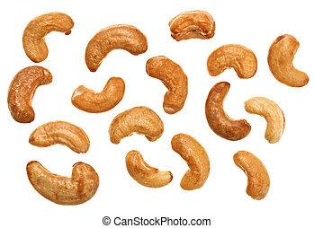 Unshelled roasted cashew nuts isolated on white, food background