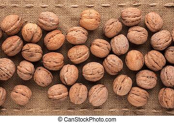 Unshelled walnut lying on sackcloth