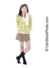unsmiling, 자부하는, 나이 적은 편의, 바이인종하다, 아시아 사람 여아, 에서, 녹색의 스웨터, 서 있는, 고립된