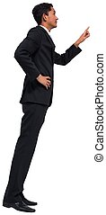 Unsmiling asian businessman pointing