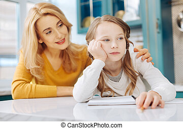 Unsmiling girl sitting with her notebook