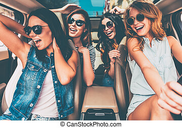 Unstoppable beauties. Four beautiful young cheerful women...