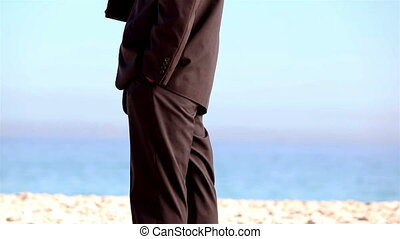 Unstressed businessman throwing his phone