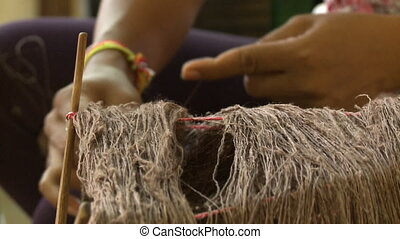 Untangling of brown silk threads at the factory - An extreme...