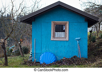 Untidy Small Blue House