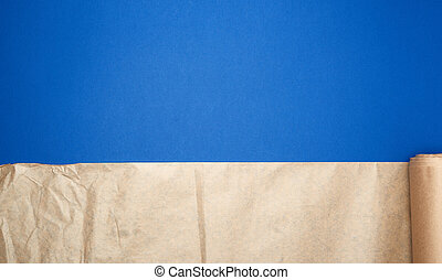untwisted roll of brown parchment paper on a blue background