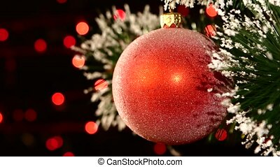 Unusual decoration - a round red toy on christmas tree, bokeh, light, black, garland