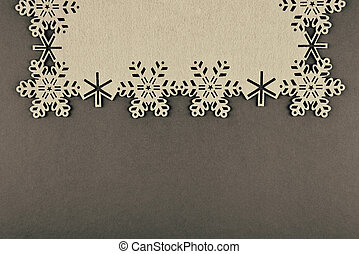 Unusual design christmas background with beige snowflakes and copy space on brown background