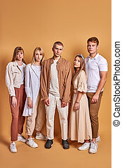 unusual group of extraordinary youth posing in trendy wear