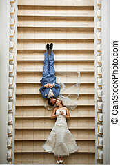Unusual photo of the couple in the wedding day