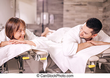 two loving people spending great time in the spa salon