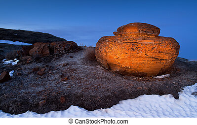 Unusual round red boulders in Red Rock Coulee in Southern Alberta, Canada.