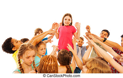 Girl is overwhelmed with popularity in class standing in the circle of kids pointing fingers at her