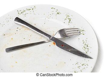 unwashed kitchen utensil - unwashed fork and knife after ...
