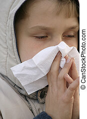 Unwell - Child blowing nose and looking unwell