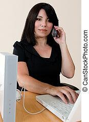 A woman making a wireless internet phone call via a wirless modem router.