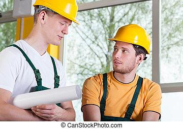 uomini, lavoro, due, hardhat, durante, tuta