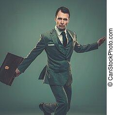 uomo affari, bene-vestito, cartella, giovane