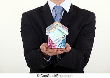 uomo affari, presa a terra, uno, casa, fatto soldi